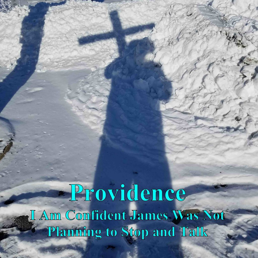 Providence: Shadow in the snow of Tony holding his cross