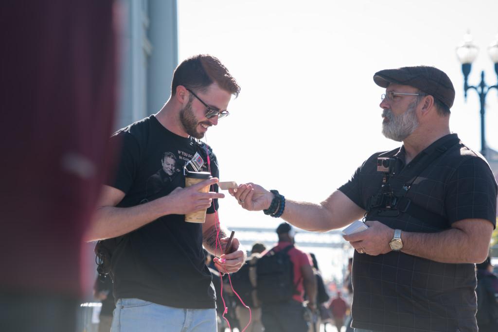 "Tony distributing gospel tracts, aka: ""Paper Missionaries,"" during the recent Super Bowl Outreach. Photo Credit: Matt De Jesus"
