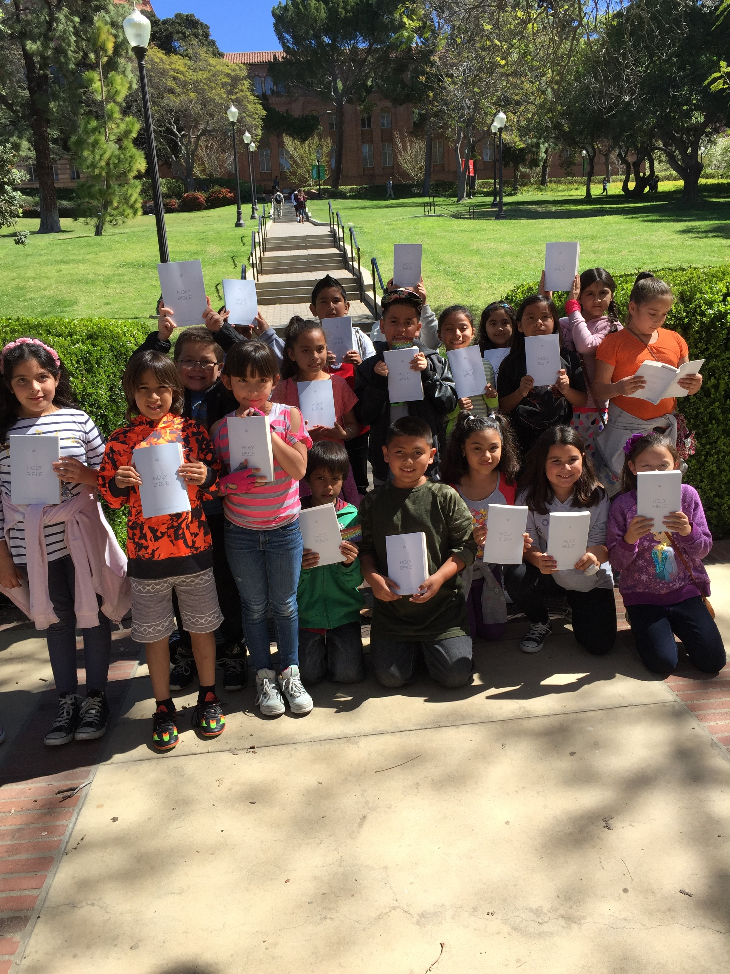 UCLA: a class picture you won't often see. An elementary school class on a field trip at UCLA receives free bibles.
