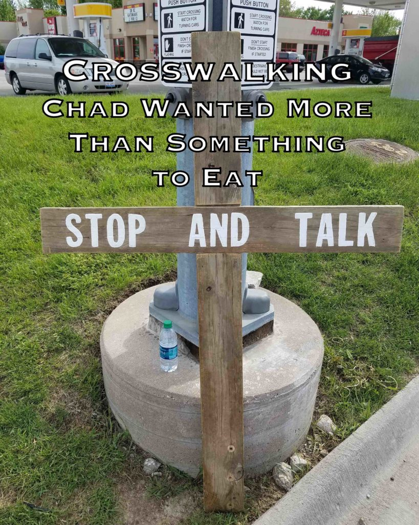 """Image of Tony's """"Stop and Talk"""" cross. This day he met Chad, a homeless man who wanted more than something to eat."""
