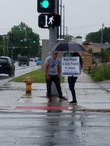 A man gives Janice an umbrella