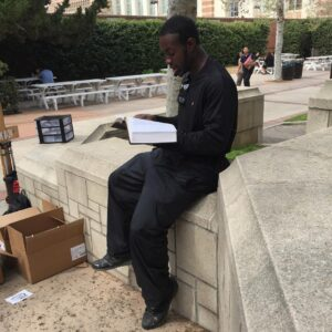 Donnie Johnson, a past project participant and now my son-in-law, reading the entire Book of Psalm in the open-air during The Timothy Project, on the campus of UCLA.